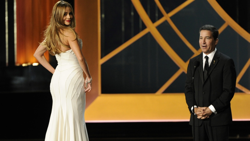 Sofia Vergara, left, and Television Academy CEO Bruce Rosenblum speak on stage at the 66th Annual Primetime Emmy Awards at the Nokia Theatre L.A. Live on Monday, Aug. 25, 2014, in Los Angeles. (AP / Chris Pizzello / Invision)