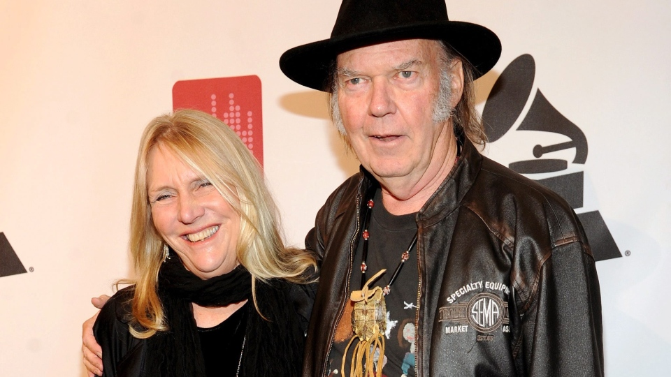 In this file photo, Neil Young, right, and Pegi Young arrive at the Producers and Engineers of The Academy's 7th Annual Grammy Week Event, at The Village Recording Studios, on Tuesday, Jan. 21, 2014, in Los Angeles. (AP / Frank Micelotta)
