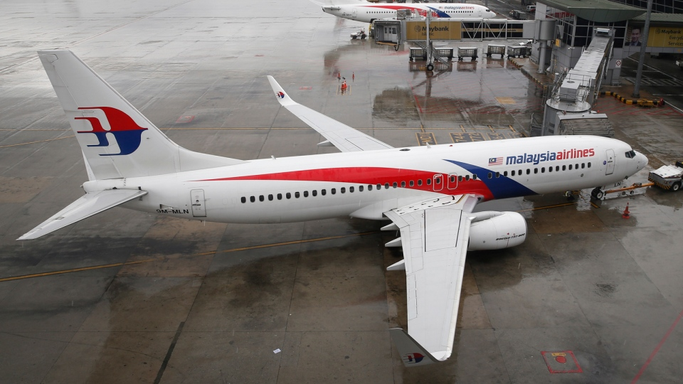 A Malaysia Airlines Boeing 737-800 plane sits on tarmac at Kuala Lumpur International Airport in Sepang, Malaysia,Aug. 8, 2014. (AP / Vincent Thian, File)