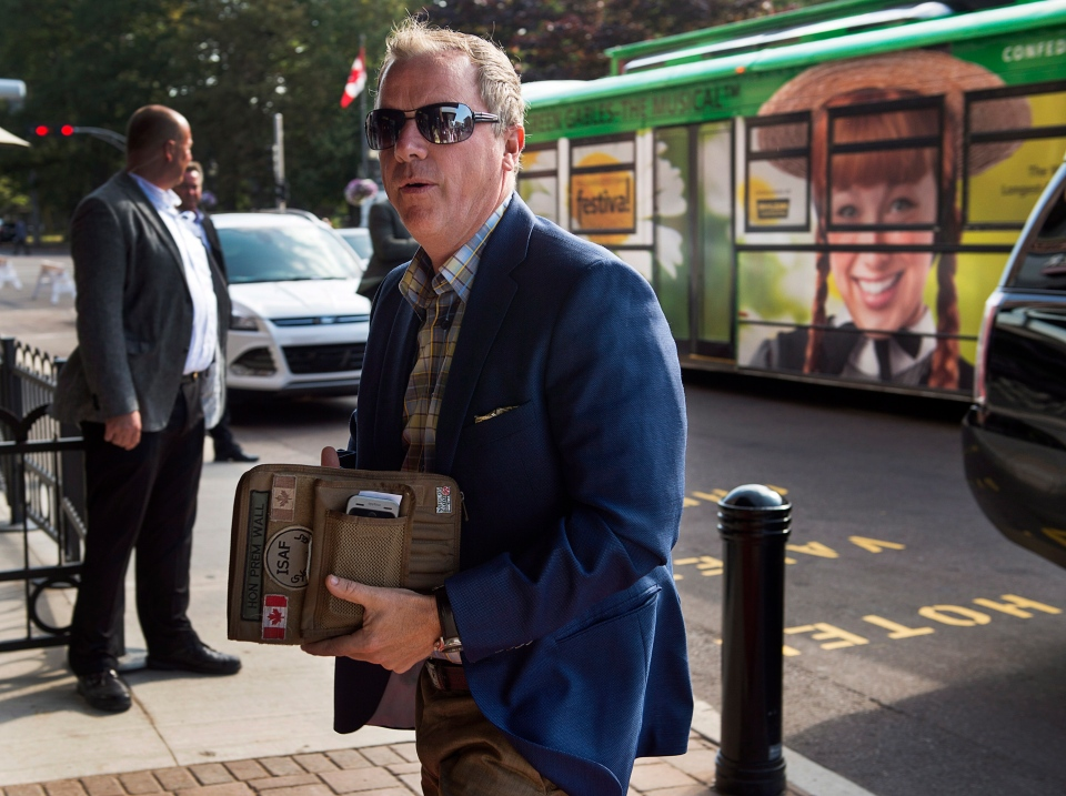 Saskatchewan Premier Brad Wall arrives for a meeting of premiers and aboriginal leaders in Charlottetown on Wednesday, August 27, 2014. (THE CANADIAN PRESS/Andrew Vaughan)