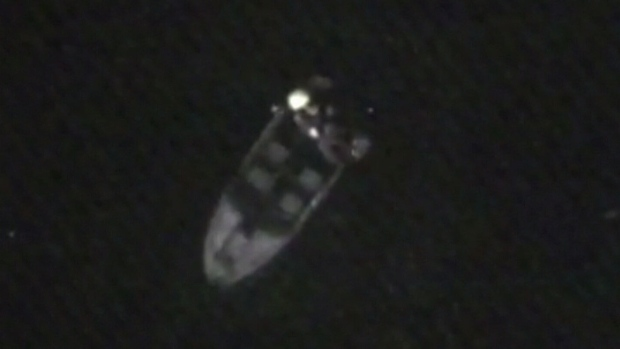 Two boaters about three kilometres from the brink of Niagara Falls were rescued from their disabled vessel by a U.S. Coast Guard helicopter, Tuesday, Aug. 26, 2014.