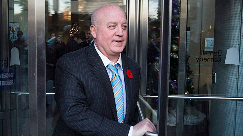 National Hockey League deputy commissioner Bill Daly leaves an NHL general manager's meeting in Toronto, Tuesday, Nov. 12, 2013. (Mark Blinch / THE CANADIAN PRESS)