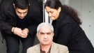Mohammad Shafia, front, Tooba Yahya, right, and their son Hamed Shafia, left, are escorted at the Frontenac County courthouse in Kingston, Ontario on Saturday, January 28, 2012.