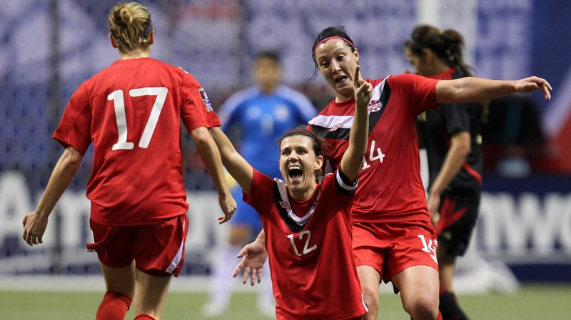 Canada's Christine Sinclair (12) celebrates her team's 3-1 win over Mexico with teammates Melissa Tancredi (14) and Brittany Timko (17) following CONCACAF women's Olympic qualifying soccer action at B.C. Place in Vancouver, B.C., Friday, Jan. 27, 2012. THE CANADIAN PRESS/Jonathan Hayward