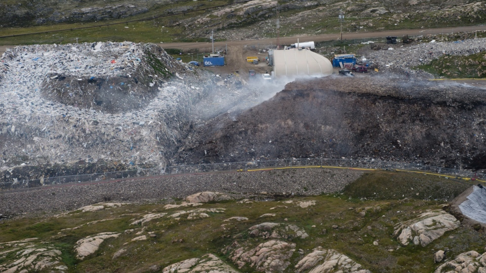 A fire at the town dump continues to smoulder, in Iqaluit, Nunavut, Tuesday, Aug. 26, 2014. (Adrian Wyld / THE CANADIAN PRESS)