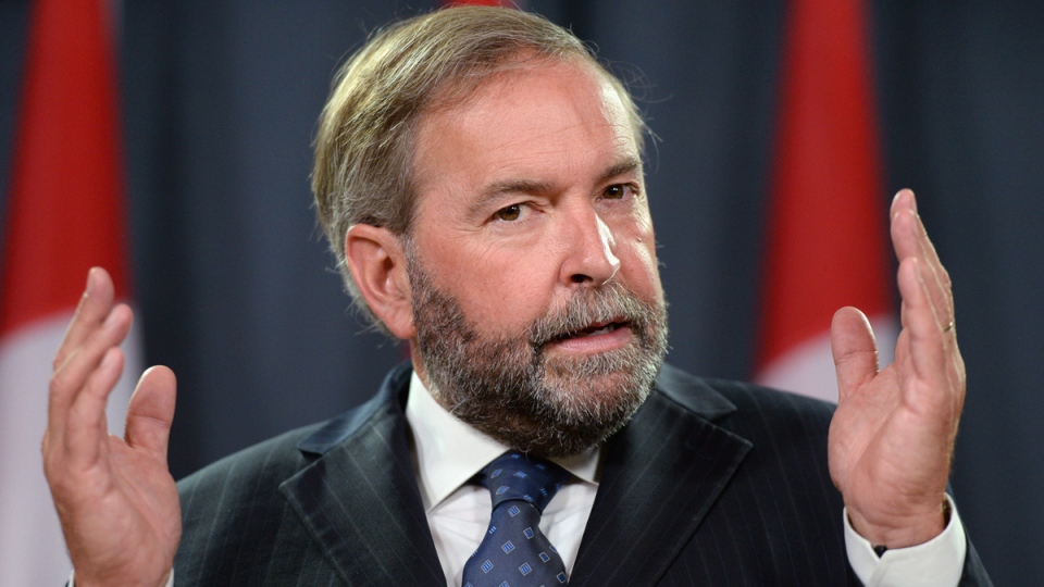 NDP leader Thomas Mulcair speaks a press conference at the National Press Theatre to discuss the need for an inquiry on missing and murdered indigenous women on Wednesday, Aug. 27, 2014. (Sean Kilpatrick / THE CANADIAN PRESS)
