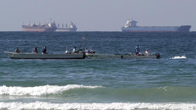 In this Jan. 19, 2012 file photo, fishing boats are seen in front of oil tankers on the Persian Gulf waters, south of the Strait of Hormuz, offshore the town of Ras Al Khaimah in United Arab Emirates.