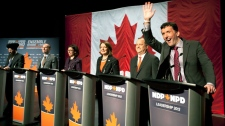 NDP federal leadership candidate Paul Dewar waves to the audience during the introduction of candidates at a leadership debate in Halifax, Sunday, Jan. 29, 2012. (Tim Krochak / THE CANADIAN PRESS)