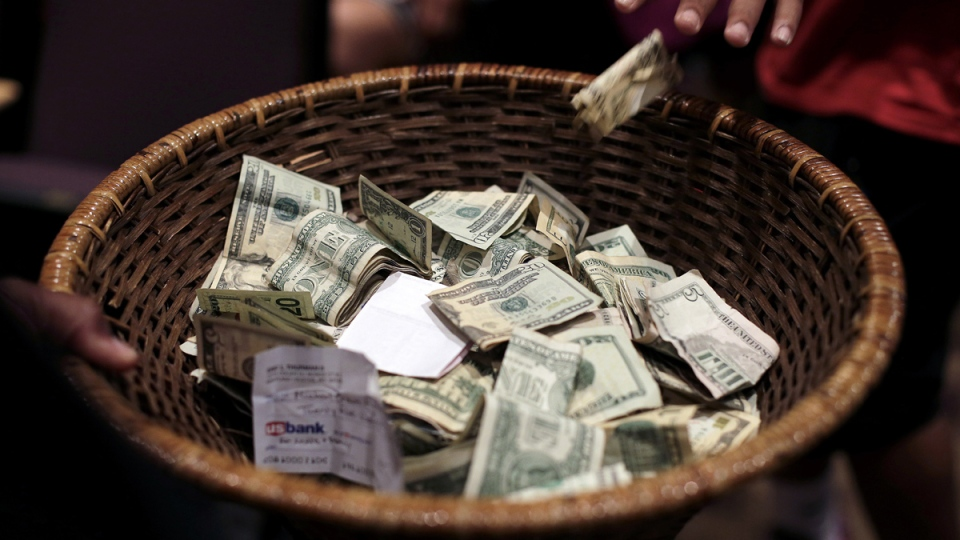 People donate money for the family of Michael Brown during a rally in Ferguson, Mo., Saturday, Aug. 9. (AP / Charlie Riedel)
