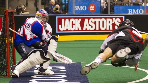 Toronto Rock goaltender Bob Watson makes a save on Washinton Stealth's Paul Rabil (right) in the National Lacrosse League championship game in Toronto on Sunday May 15, 2011.
