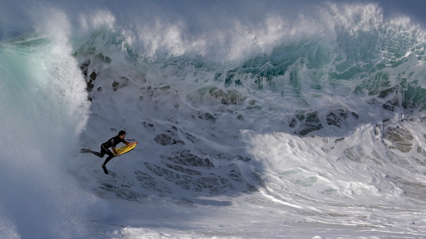 The Southern California coast is seeing huge waves as Hurricane Marie bears down. Surfers were urged to be aware of the dangerous conditions, but that didn&#39;t stop them from hitting the waves. <br> <br> A boogie boarder rides a wave at the Wedge in Newport Beach, Calif., Wednesday, Aug. 27, 2014. (AP / Chris Carlson)