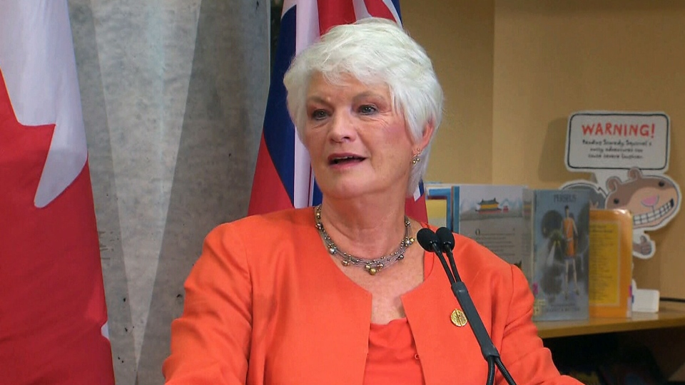 Education Minister Liz Sandals speaks to reporters on Wednesday, Aug. 27, 2014.
