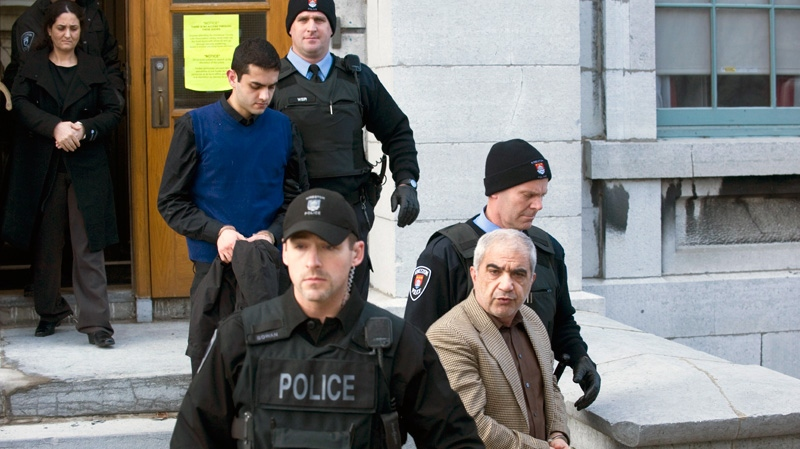 Mohammad Shafia, front, Tooba Yahya, left, and Hamed Shafia, centre, are led from the Frontenac County courthouse after being found guilty of first-degree murder in Kingston, Ont., Sunday, Jan. 29, 2012. (Graham Hughes / THE CANADIAN PRESS)