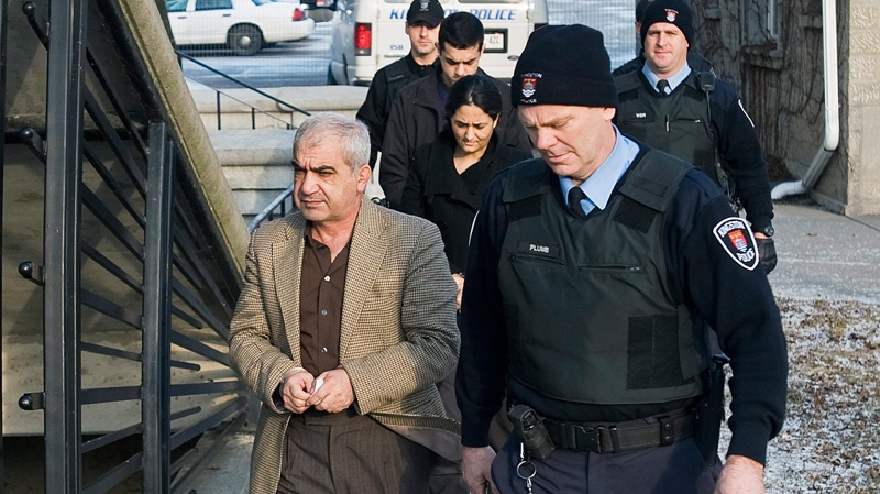 Mohammad Shafia, front, Tooba Yahya, centre and Hamed Shafia arrive at the Frontenac County courthouse in Kingston, Ont., Sunday, Jan. 29, 2011.