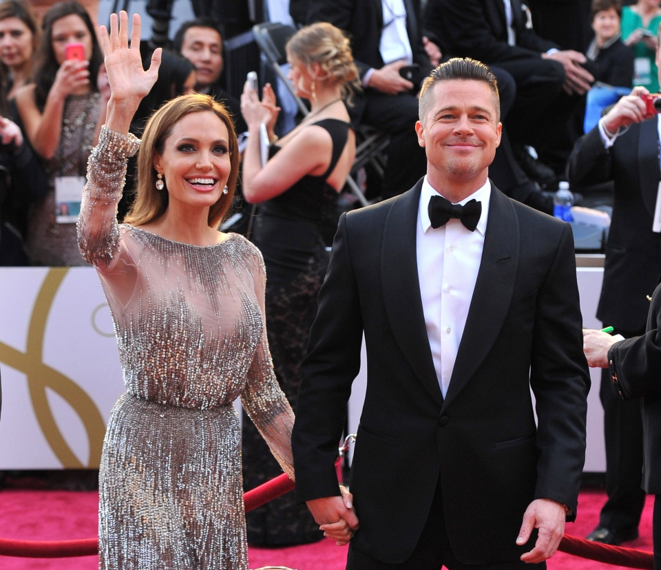 Angelina Jolie and Brad Pitt arrive at the Oscars at the Dolby Theatre in Los Angeles, Sunday, March 2, 2014. (Vince Bucci / Invision)