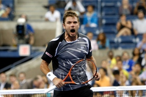 Stan Wawrinka, of Switzerland, reacts after defeating Thomaz Bellucci, of Brazil, 6-3, 6-4, 3-6, 7-6 (1) during the second round of the U.S. Open tennis tournament early Thursday, Aug. 28, 2014, in New York. (AP Photo/Jason DeCrow)