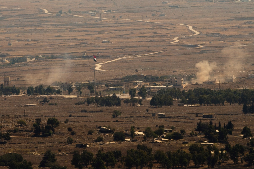 Columns of smoke rise following explosions in Syria's Quneitra province as Syrian rebels clashed with President Bashar Assad's forces, seen from the Israeli-controlled Golan Heights, Thursday, Aug. 28, 2014. (AP / Ariel Schalit)