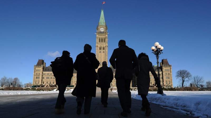 People make their way towards the Centre Block of Parliament Hill as business resumes following the winter break in Ottawa on Monday, Jan. 30, 2012. (Sean Kilpatrick / THE CANADIAN PRESS)