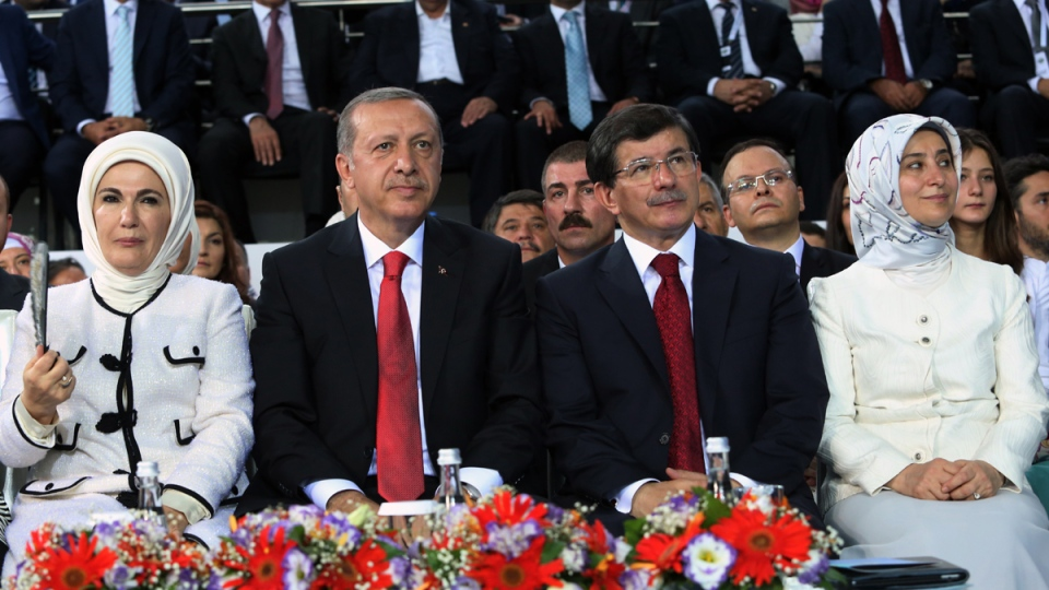 President-elect Recep Tayyip Erdogan, second left, Foreign Minister Ahmet Davutoglu, second right, Erdogan's wife Emine Erdogan, left, and Davutoglu's wife Sare Davutoglu attend a rally, in Ankara, Turkey, Wednesday, Aug. 27, 2014. (AP / Rasit Aydogan)