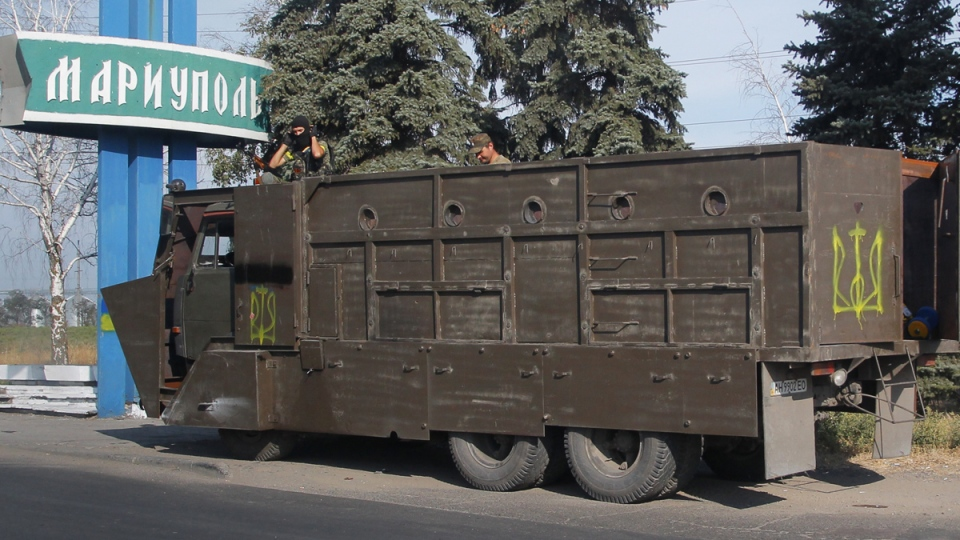 Armoured truck with Ukrainian forces guard at a checkpoint in the town of Mariupol, eastern Ukraine, Thursday, Aug. 28, 2014. (AP / Sergei Grits)