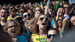 Ryerson University students in Toronto react after unofficially breaking the Guiness World Record for the largest soul train dance as part of their orientation week activities, Wednesday, August 28, 2013. (Galit Rodan / THE CANADIAN PRESS)