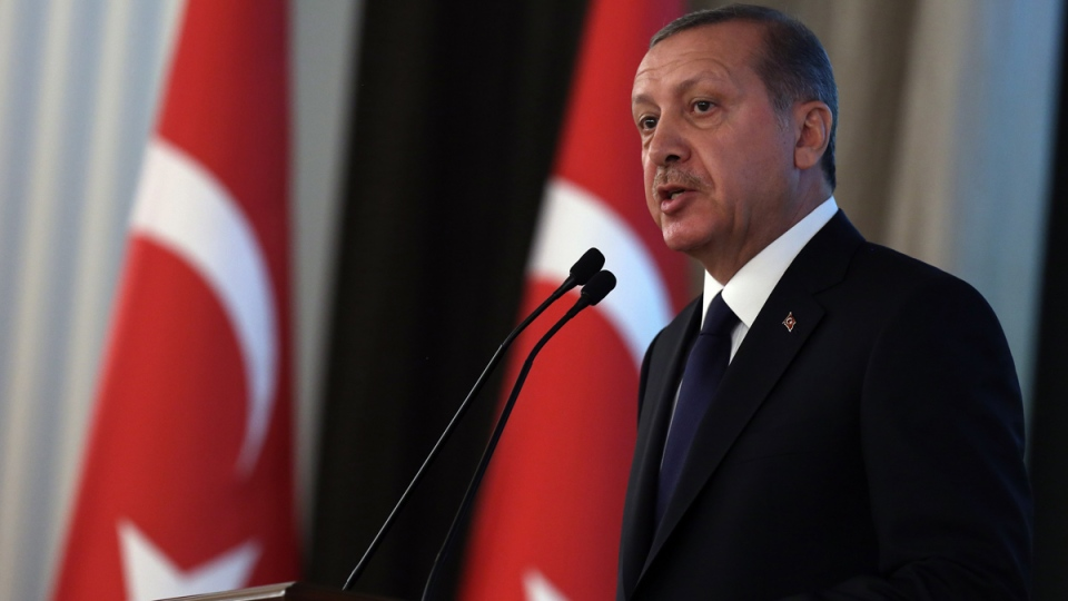 Turkey's new President Recep Tayyip Erdogan speaks during a ceremony where he formally took charge of the presidency from his predecessor, Abdullah Gul, at the Cankaya Palace in Ankara, Turkey, Thursday, Aug. 28, 2014. (AP / Burhan Ozbilici)
