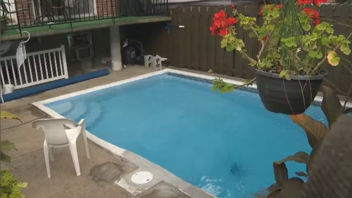 Montreal police were called to an east end home just after 11 a.m. Thursday after a mother and her friend pulled a 13-month-old boy out of this backyard pool.