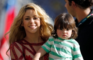 In this July 13, 2014 file photo, singer Shakira carries her son Milan after she performed during the closing ceremony prior to the World Cup final soccer match between Germany and Argentina at the Maracana Stadium in Rio de Janeiro, Brazil. The singer is pregnant with baby No. 2. Shakira made the announcement on her Facebook and Twitter pages on Thursday, Aug. 28, 2014. (AP/Frank Augstein, file)