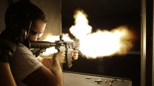 Brad Whitehead of Manchester, England fires a fully automatic machine gun at Machine Guns Vegas, in Las Vegas, Thursday, Aug. 28, 2014. (AP / John Locher)