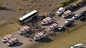 Paramedics are on scene following a tour bus crash on the Coquihalla Highway southwest of Merritt, Thurs., Aug. 28, 2014.