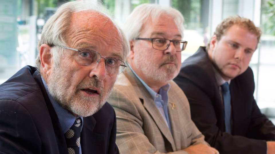 Thomas Walsh, left, lawyer defending train conductor Tom Harding, Daniel Roy, centre, Quebec director of the United Steel Workers and Marc-Andre Cloutier, director of Juripop, a legal clinic, claim that criminal charges against two men accused in the Lac-Megantic tragedy should be dropped in Montreal on Thursday, Aug. 28, 2014. (Paul Chiasson / THE CANADIAN PRESS)