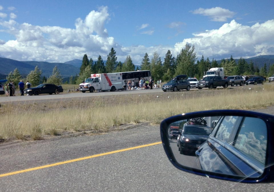 Emergency response teams attend the scene of the B.C. bus crash, about 30 kilometres outside Merritt on the Coquihalla highway on Thursday, Aug. 28, 2014. (Daniel Parsons / THE CANADIAN PRESS)