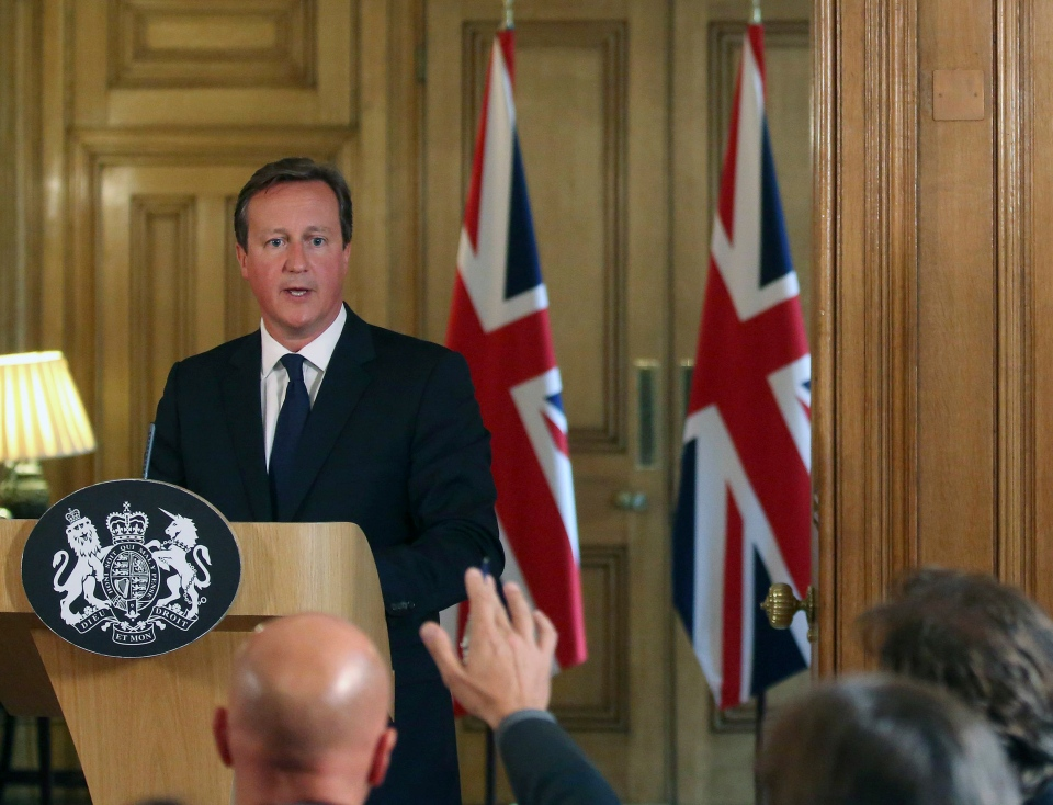 British Prime Minister David Cameron looks to answer questions from journalists during a media conference in Downing Street, London, Friday Aug. 29, 2014. (AP / Paul Hackett)