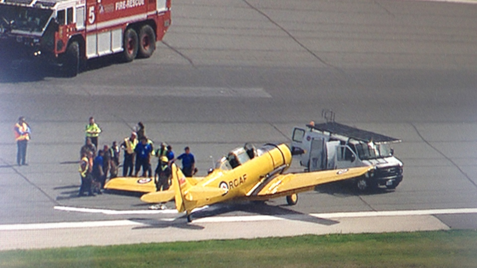 Emergency services inspect a plane after it skidded and crashed at Pearson Airport on Friday, Aug. 29, 2014. (Ted Brooks / CTV News)