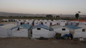Syrians who fled their home from Syria walk outside their tents at a Syrian refugee camp in the eastern town of Marj in Bekaa valley, Lebanon, Sunday, June 29, 2014. (AP / Bilal Hussein)