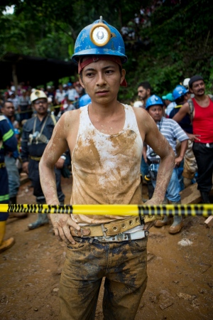 A miner takes a break from the rescue operations at El Comal gold and silver mine after a landslide trapped at least 26 miners inside, in Bonanza, Nicaragua, Friday, Aug. 29, 2014. (AP /Esteban Felix)