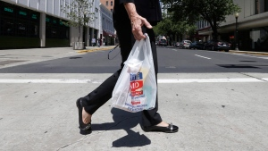 Walking with a plastic bag in Sacramento