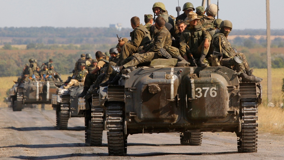 Ukrainian troops evacuated from the rebel-held town of Starobesheve, Ukraine, on Aug. 30, 2014. (AP / Sergei Grits)
