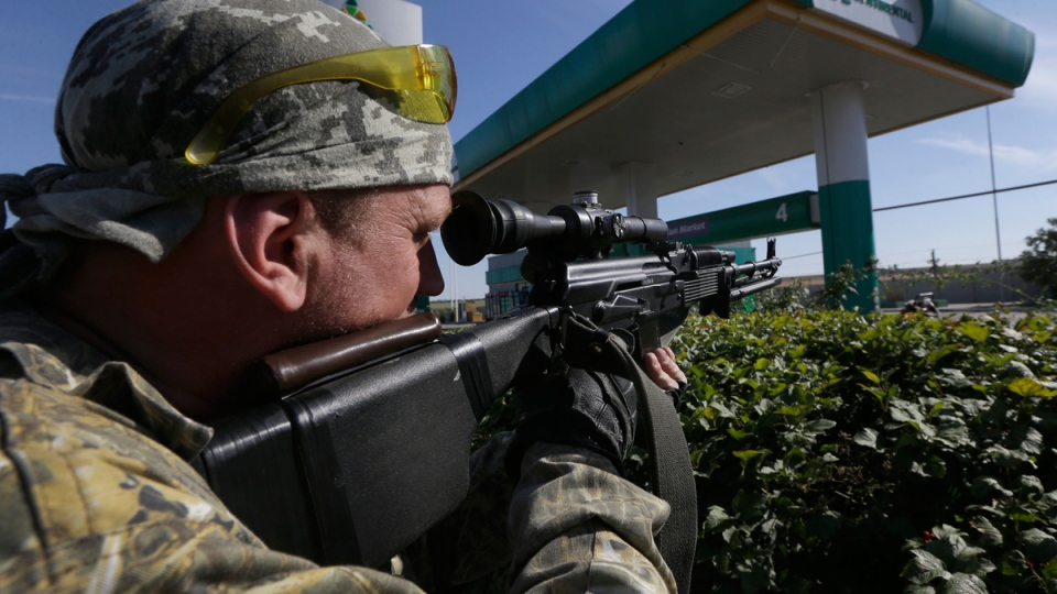 A pro-Russian rebel aims his rifle in the rebel-held town of Starobesheve, eastern Ukraine, Saturday, Aug. 30, 2014. (AP / Sergei Grits)