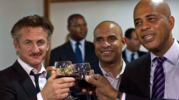 Actor Sean Penn, right, and Haiti's President Michel Martelly, shake hands as they pose for pictures after a special ceremony at the national palace in Port-au-Prince, Haiti, Tuesday, Jan. 31, 2012. (AP / Ramon Espinosa)
