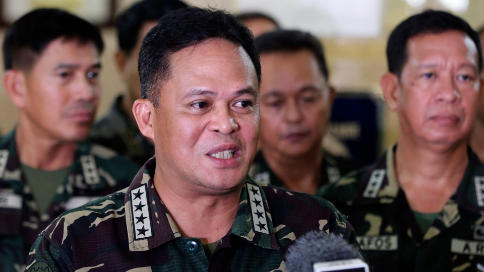 Philippine military chief Gen. Gregorio Pio Catapang answers questions from reporters about the situation of Filipino peacekeepers in Golan Heights, during a press conference at Camp Aguinaldo military headquarters in suburban Quezon city, Philippines on Sunday Aug. 31, 2014. (AP / Aaron Favila)