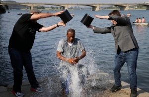 Two-time Grammy award winning rapper and a founding member of the Fugees, Pras Michel, gets doused by his friends for the ALS Ice Bucket Challenge, Sunday, Aug. 31, 2014 in Pyongyang, North Korea. (AP / Wong Maye-E)