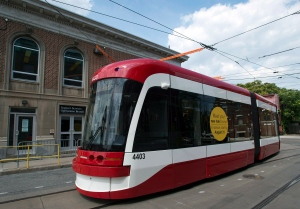 A new Toronto Transit Commission streetcar rounds a turn in Toronto on Thursday July 31, 2014. (Frank Gunn /The Canadian Press)