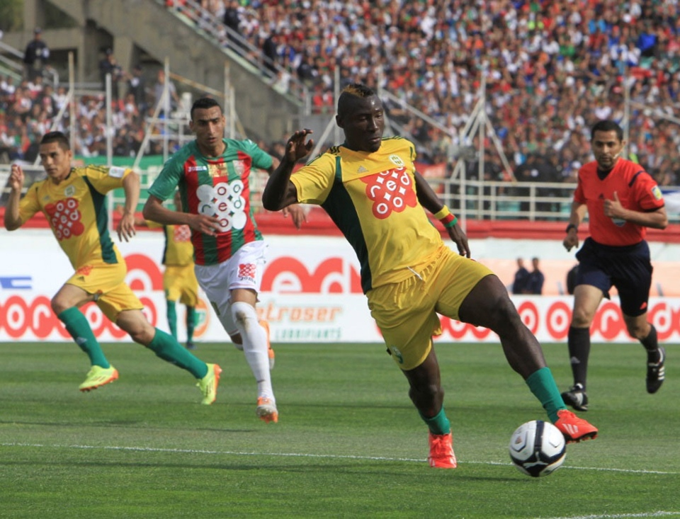 In this photo dated May 2, 2014, JS Kabylie striker Albert Ebosse of Cameroon controls the ball during the final of the Algerian soccer Cup in Blida near the Algerian capital, Algiers. Ebosse died after being hit in the head by an object thrown from the crowd at a top-flight league game in Algeria last August 23, 2014. (AP)