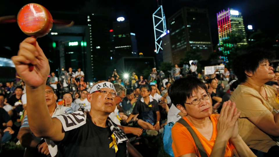 Protesters attend a protest rally in Hong Kong, Sunday, Aug. 31, 2014. (AP / Vincent Yu)