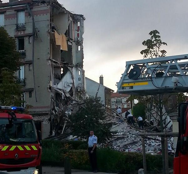 An explosion destroyed a building in Rosny-Sous-Bois, a Paris suburb, this morning, Sunday, Aug. 31, 2014, killing a child and an elderly person. (Twitter / MarsegliaOlivia)