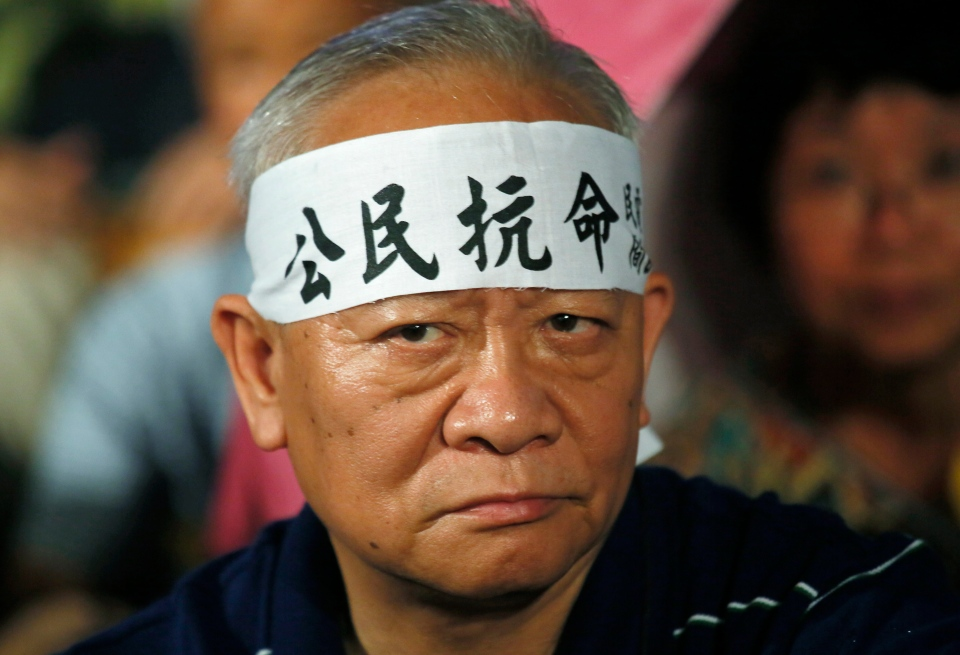 A protester wears a headband with Chinese characters reading 'Citizen disobedience' during a rally in Hong Kong on Sunday, Aug. 31, 2014. (AP / Vincent Yu)