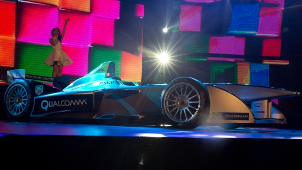 A singer performs at an unveiling of an all-electric race car Sunday, Aug. 31, 2014 ahead of the Sept. 13 inaugural Formula E auto race in Beijing, China. <br> <br> Organizers of the FIA Formula E Championship are giving gas-powered race cars a run for their money with the first series exclusively for electric cars. Racing aficionados got a chance to see one of the cars at a special unveiling Sunday, Aug. 31, 2014. (AP / Ng Han Guan)