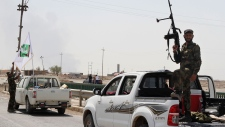 Shiite militiamen patrol in Amirli