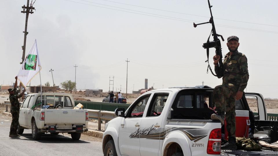 Shiite militiamen patrol in Amirli, 105 miles (170 kilometers) north of Baghdad, Iraq, Sunday, Aug. 31, 2014. (AP Photo)